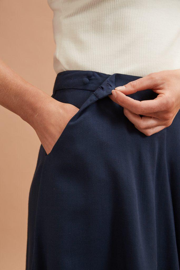 Cowl skirt waist opening detail